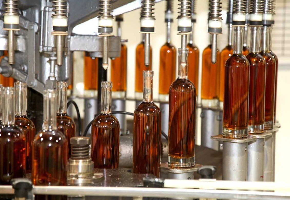 whisky getting bottled in distillery